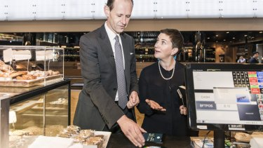 ANZ Bank chief executive Shayne Elliott tries out Android Pay, alongside general manager of deposits and payments, Katherine Bray.