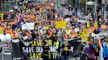 Heyfield  timber mill supporters gather outside State Parliament to protest its closure.