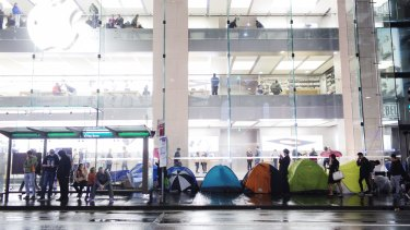 Members of the public camp outside Apple's flagship Sydney store on George Street.