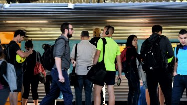 Commuters wait for the train at Strathfield station on Monday.