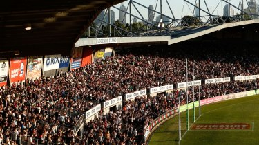 It's a sell-out: Punters cram in to watch Carlton thump Collingwood in the first AFLW match at Princes Park.