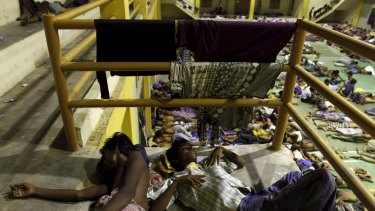 Migrants believed to be Rohingya rest inside a shelter after being rescued by fishermen at Lhoksukon in Indonesia's Aceh Province on Monday.