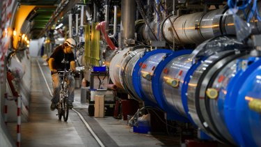 A worker on a bike inside the tunnel of the Large Hadron Collider near Geneva.