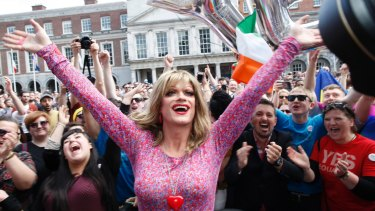 Rory O'Neill, known by the Drag persona Panti, celebrates with yes supporters at Dublin Castle after the result of Ireland's same-sex marriage vote was announced in 2015.