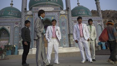 Hazara youths accompany one of their friends to his wedding in Kabul. Both Islamic State and the Taliban have made the Shiite Hazaras their targets.