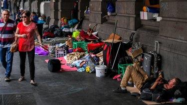 A large homeless camp outside Flinders Street Station.