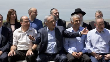Israeli Prime Minister Benjamin Netanyahu, centre, poses with his ministers on the Israeli-occupied Golan Heights on Sunday.