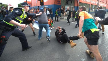 Police intervene to stop the violence.