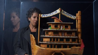 Andrea Durbach with the model boat built for her by 25 convicted murderers in South Africa.