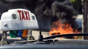 French taxi drivers burn tyres during a protest against Uber in Marseilles.
