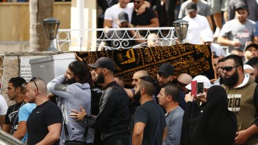Relatives and friends of Safwan Charbaji, who was shot dead in Condell Park, carry his coffin outside Lakemba Mosque.
