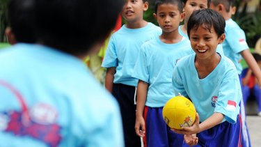 Students play Aussie Rules at an elementary school in Jakarta.