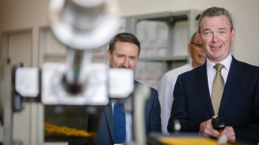 Minister for Defence Industry Christopher Pyne takes the controls while touring a new Electro Optic Systems (EOS) facility.