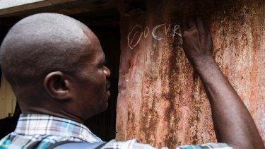 Workers conduct a door-to-door cholera vaccination.