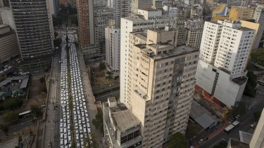 Backlash: taxi drivers block a street to protest Uber in Sao Paulo, Brazil last year.