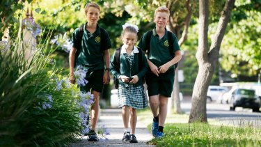 Henry, 11, Annabel, 8, and Tom Feeney, 10, walk to school by themselves.
