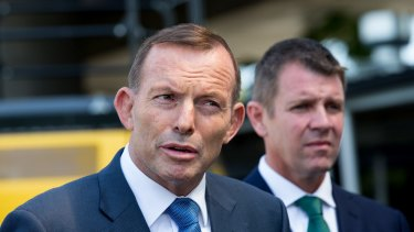 Prime Minister Tony Abbott and  Premier Mike Baird at Granville on Sunday.