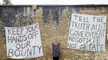 Norfolk Island resident Kim Edward at a protest camp at the site of the axed Legislative Assembly.