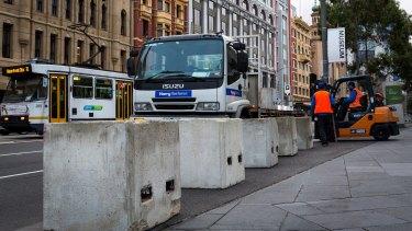 Temporary concrete bollards were installed around Federation Square on Saturday.