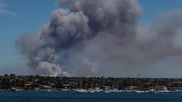 Smoke visible from Captain Cooks Bridge, rising off an out-of-control bushfire burning in the Royal National Park.