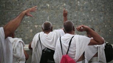 Muslim pilgrims cast stones at a pillar symbolising Satan at Mina on Thursday.