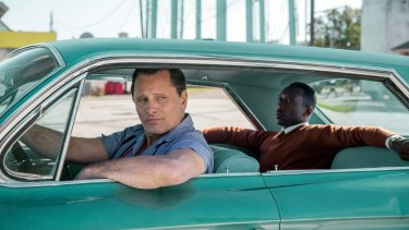 In Green Book, Tony Lip (Viggo Mortensen), left, drives Dr Don Shirley (Mahershala Ali), a renowned pianist, on a tour of the south in 1962.