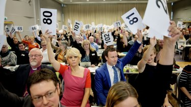 Norwegian Church Council leader Kristin Gunleiksrud Raaum (80) and chairman of the Oslo diocesan council Gard Sandaker-Nielsen (81) vote with others to marry same-sex couples.