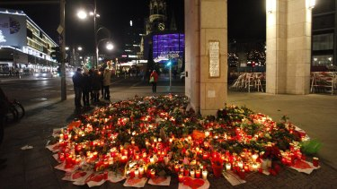 Flowers and candles at the site near the Christmas Market in Berlin.