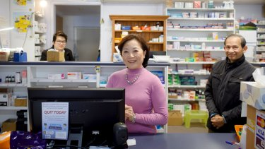 Liem, Kim, and Tan Dang are trying to stay positive about the future of the Narrabundah Pharmacy despite growing pressure from competitors.