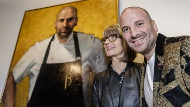 George Calombaris and artist Betina Fauvel-Ogden celebrate Fauvel-Ogden's portrait of the chef  being named the winner of the Archibald Prize's Packing Room Prize.