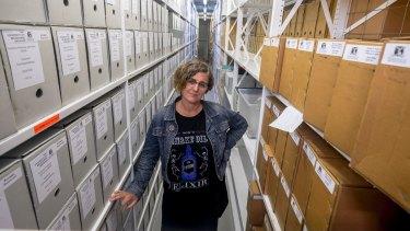 Dr Rachel Buchanan with items in the Germaine Greer archive.