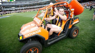Brian Lake celebrates at the MCG in the aftermath of Hawthorn's premiership win.