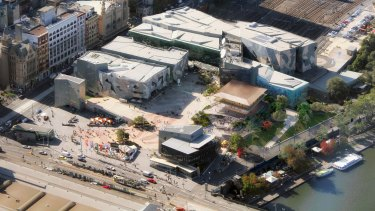 The proposed Apple store (gold roof) is a departure from the rest of Fed Square's look.