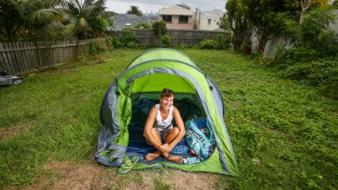 Backpacker Kimberley Boutard from Paris camping in the backyard of a Dover Heights home in Sydney on Saturday.