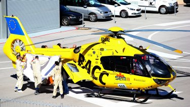 Serious accident: Fernando Alonso of McLaren Honda is transferred from the medical centre to the helicopter after crashing during day four of Formula One Winter Testing at Circuit de Catalunya on February 22.