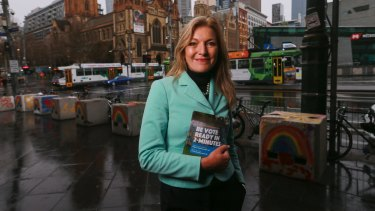 Fiona Patten hands out how to vote cards for marriage equality at Flinders Street Station.