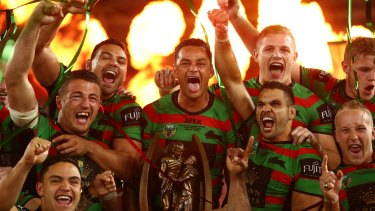 Glory daze: John Sutton leads the celebrations as Souths break their 43-year drought in 2014.