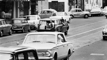 Traffic, Toorak Rd, c.1970.