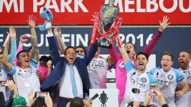 Paradise City: Tim Cahill, City coach John van 't Schip and captain Bruno Fornaroli celebrate.