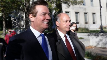 Paul Manafort, left, leaves Federal District Court in Washington on Monday.