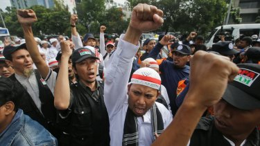 Hardline Muslims shout slogans during a rally outside the court where Jakarta governor Ahok is on trial.