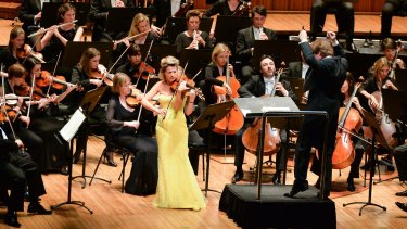 Anne-Sophie Mutter shares the spotlight with the Sydney Symphony Orchestra at the Sydney Opera House.