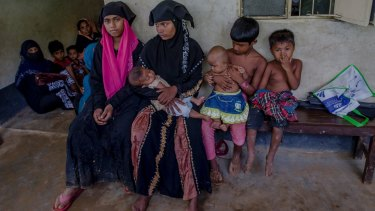 Rohingya women and children wait for treatment at a health complex run in a refugee camp in Bangladesh.