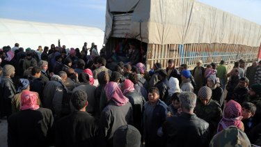 Refugees who have fled bombing in Aleppo wait at the Bab al-Salam crossing, opposite the Turkish province of Kilis, on Friday.