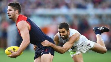 Good grab: Melbourne's Jesse Hogan shrugs a tackle from Carlton's Kade Simpson.