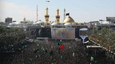 Iraqi Shiite Muslims gather outside the shrine of Imam Hussein in the Iraqi city of Karbala.