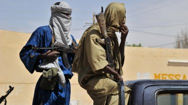 Islamist policemen patrol the streets of Gao, northern Mali in 2012. Once one of west Africa's most stable democracies, Mali was plunged into turmoil when soldiers seized power in Bamako that year.