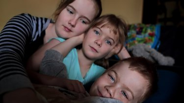 Oshin with his sisters Amitiel (12) and Shilah (8), who are confused and frightened by their brother's situation.