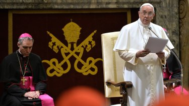 Blistering critique of administrators ... Pope Francis delivers his message during a meeting with Cardinals and Bishops of the Vatican Curia. He suggested they needed a 'dose of humour'.