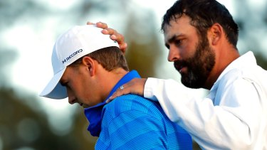 Jordan Spieth (left) and caddie Michael Greller react after finishing on the 18th green during the final round of the US Masters.